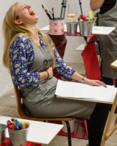 girl having fun on a painting workshop