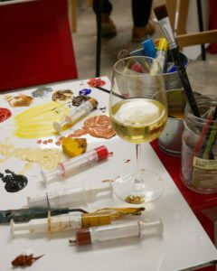 painting materials and wine