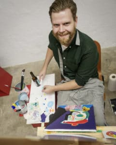 painter with easel, canvas and a drink