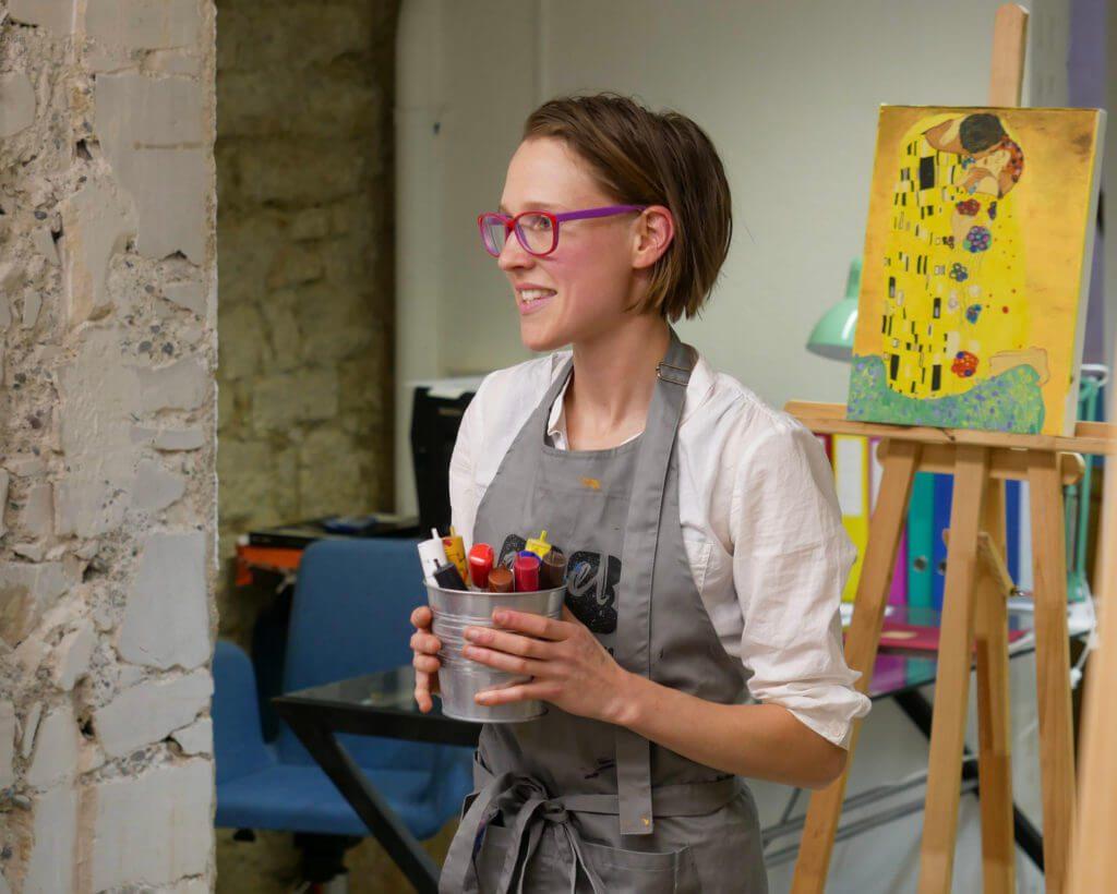 Instructor explains the use of acrylic paint