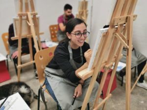 delighted girl on painting workshop
