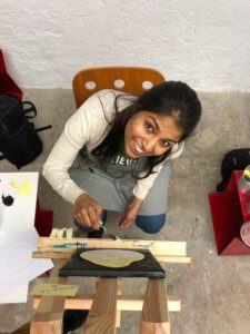 girl painting with acrylics in the studio