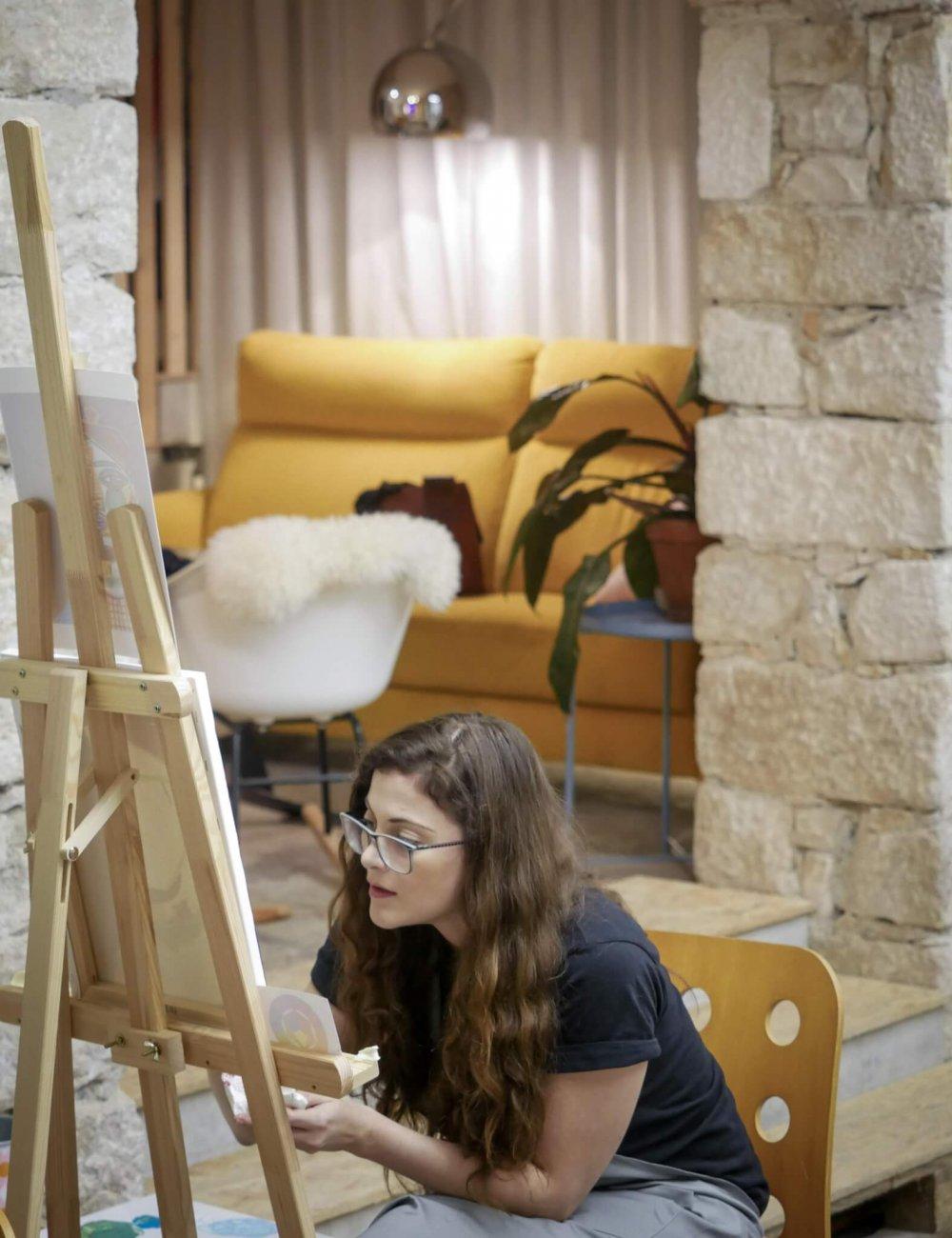 girl meditating over her acrylic artwork
